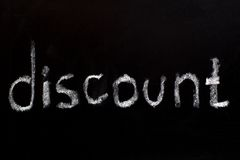 Word discount writtent on blackboard Royalty Free Stock Photography