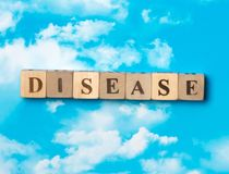 The word Disease. On the sky background stock photos