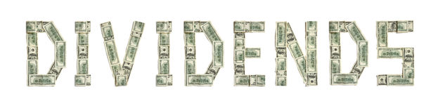 Word `DIVIDENDS` made of dollars. Photography of money made word - on white background. Top view. High resolution product royalty free stock photo