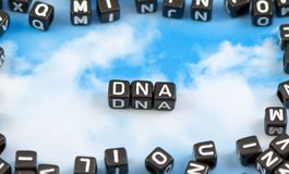 The word DNA. On the sky background stock photography