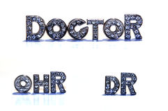 Word DOCTOR / DR on white background. Letters with rhinestone form the german and english words DOCTOR / DR and OHR isolated on white background, Symbol / Stock Photo