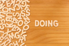 Word doing made with block wooden letters Royalty Free Stock Photography