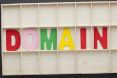 Word Domain Concept. Word Domain made of colorful alphabet letters on wooden surface royalty free stock photography