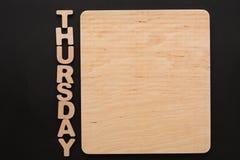 Word Donderdag met lege houten raad Royalty-vrije Stock Foto's