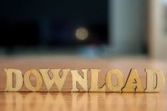 The word `download` made of wooden letters royalty free stock photo