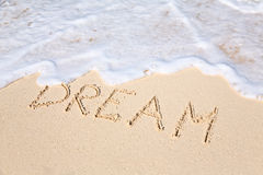 Word DREAM on beach - vacation concept background Royalty Free Stock Image