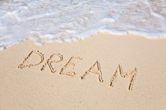 Word DREAM on beach - vacation concept background stock photo