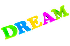 Word dream. From colorful magnetic letters white isolated stock photos