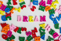 The word dream from the colorful wooden letters. On a white wooden background royalty free stock photo