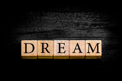 Word DREAM isolated on black background with copy space Royalty Free Stock Images