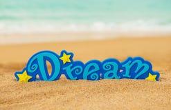 Word Dream on the sand Stock Photos