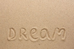 The word  dream  written on the sand Stock Photos