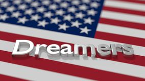 The word dreamers on an american flag daca immigration concept Stock Photo