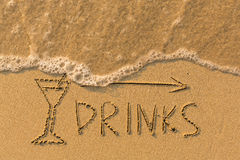 Word Drinks and arrow drawn on the sand Stock Photography