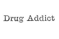 The word `Drug Addict` from a typewriter on white Royalty Free Stock Image