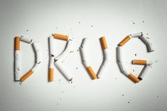 Word DRUG, made of cigarettes Royalty Free Stock Photo