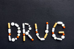 Word DRUG made of various pills Royalty Free Stock Photo
