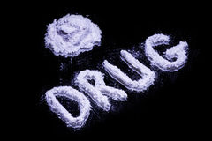 Word Drug and a pile of white drug. On a mirror Royalty Free Stock Photography