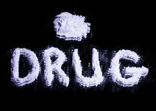 Word Drug and a pile of white drug Stock Photography