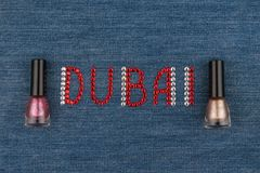Word Dubai, made of rhinestones, encrusted on denim. World Fashion. Stock Photography