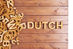 Word dutch made with wooden letters Stock Photos