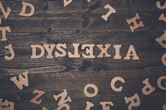 Word dyslexia on a wooden background Royalty Free Stock Image