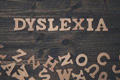 Word dyslexia on a wooden background Royalty Free Stock Photos