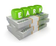 Word EARN on stack of dollars. Stock Photo