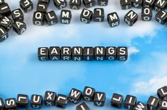 The word earnings. On the sky background Royalty Free Stock Photography