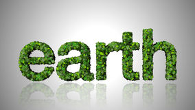 Word earth made from green leaves  on white background. Stock Image
