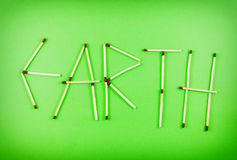 Word EARTH made of matchsticks Royalty Free Stock Photography