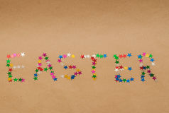 Word easter on kraft background Royalty Free Stock Images