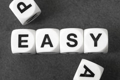 Word easy on toy cubes Stock Photography