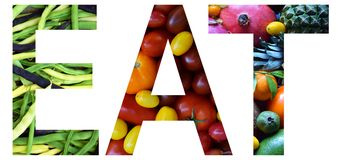 Word eat laid out to from colourful multi-colored fruits and vegetables. Healthy food concept. Vegetarian product. Organic Raw Pro. Duce Royalty Free Stock Image