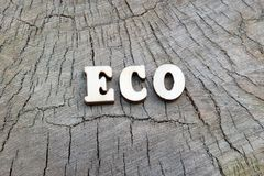 The word ECO is made up of wooden letters on the old stump. The concept of nature protection, resource and ecology. Copy space for. The word ECO is made up of royalty free stock images