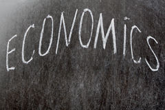 Word Economy. Economics Chalk Board Economy. word Economics written on blackboard Stock Images
