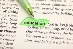 The word education highlighted on dictionary Stock Image
