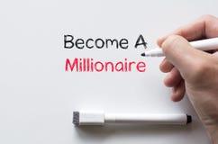 Word een miljonair op whiteboard wordt geschreven die Royalty-vrije Stock Afbeeldingen
