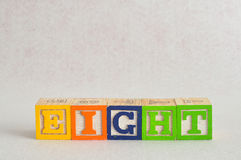 The word eight (8) spelled with colorful alphabet blocks. Isolated against a white background stock images