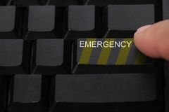 Emergency button on a computer keyboard. Word emergency button on a computer keyboard royalty free stock images