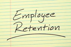 Employee Retention On A Yellow Legal Pad. The word `Employee Retention` underlined on a yellow legal pad Royalty Free Stock Images