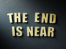 The word The End Is Near on paper background Royalty Free Stock Photography