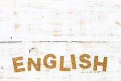 The word english cork on white wood Royalty Free Stock Photo