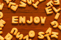The word enjoy written with cracker Royalty Free Stock Photography