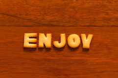 The word enjoy written with cracker Royalty Free Stock Photo