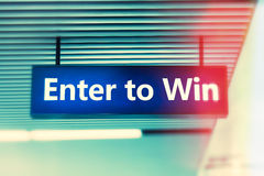 Word enter to win on motion blur advertising board Stock Photos