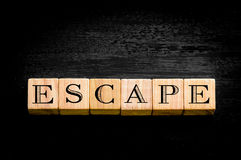 Word Escape isolated on black background Stock Image