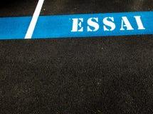 The word ESSAI painted on asphalt Stock Photos