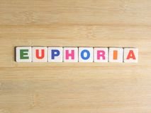 Word Euphoria on wood background.  royalty free stock photography