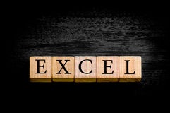 Word EXCEL isolated on black background with copy space. Word EXCEL. Wooden small cubes with letters isolated on black background with copy space available stock photo